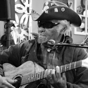 Playing some blues by Mary Wright - Uncategorized All Uncategorized ( music, musical instrument, black and white, guitar,  )