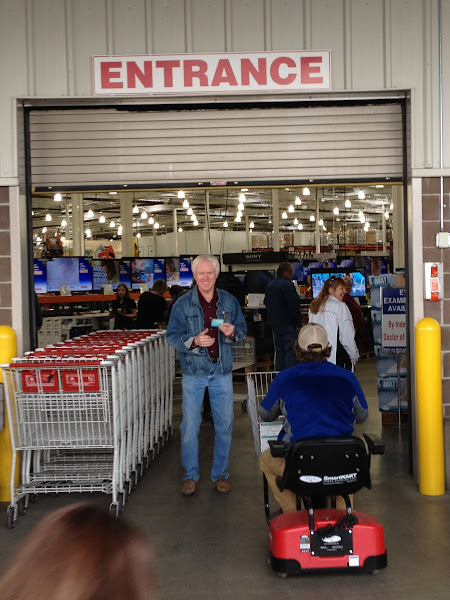 "Photo: Headed in. This is one of those ""Membership"" stores, so on the way in, we got Daddy J a motorized cart and got the card checked."