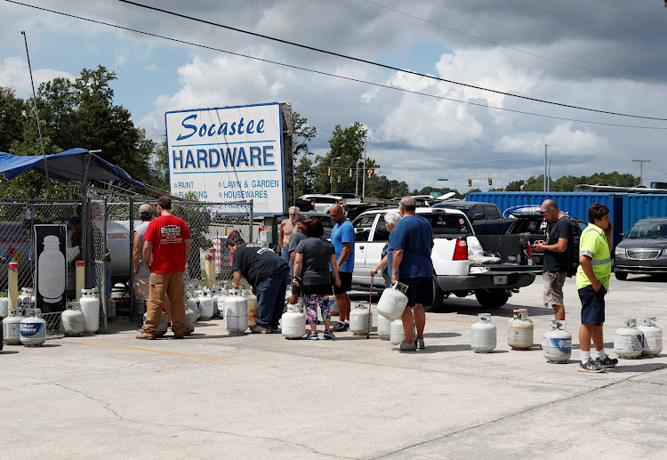 Customers line up to buy propane at Socastee Hardware store ahead of the arrival of hurricane Florence in Myrtle Beach, South Carolina, US.