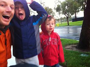 Photo: Daddy and Boys Rainy Walk