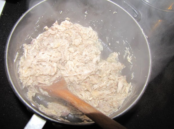 Put the shredded chicken along with the broth, cumin, and garlic powder, salt and...