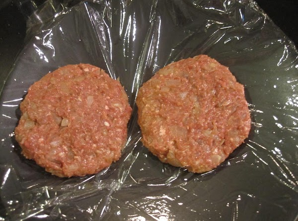 Mix burger ingredients together in a bowl. Form hamburger balls and flatten them out...