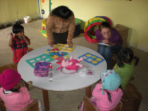 Photo: Menda teaching the kids about what a plant needs to grow.