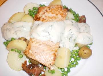 Grilled Salmon w/Dill Sauce over steamed potatoes, peas and bacon