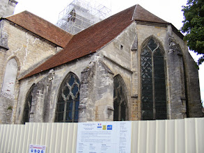Photo: Lots of construction underway in the closed church. The sign on the fence notes that restoration started just a few months ago, and is due for completion in 2015.