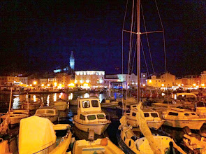 Photo: Our first view of Rovinj at night.  LOTS of people partying on this Rovinj Day festivities with fireworks, bands, etc.