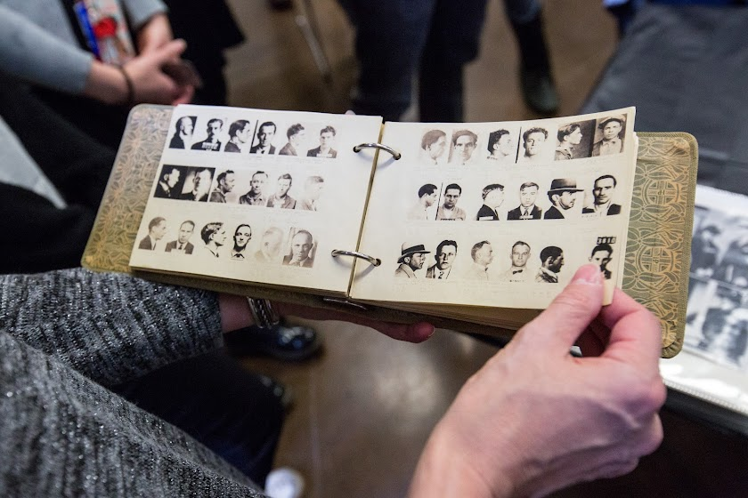 Reviewing early 20th-century mugshots in a course called True Crime