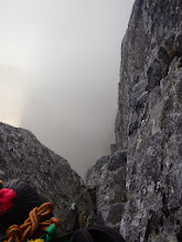 Photo: Hours pass and...here I am partway up the first pitch, nothing but air below.