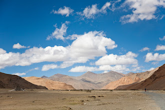 Photo: A russian touring bicyclist (lower right) is passing an abandoned nomad tent, Morei Plains, Ladakh, Indian Himalayas