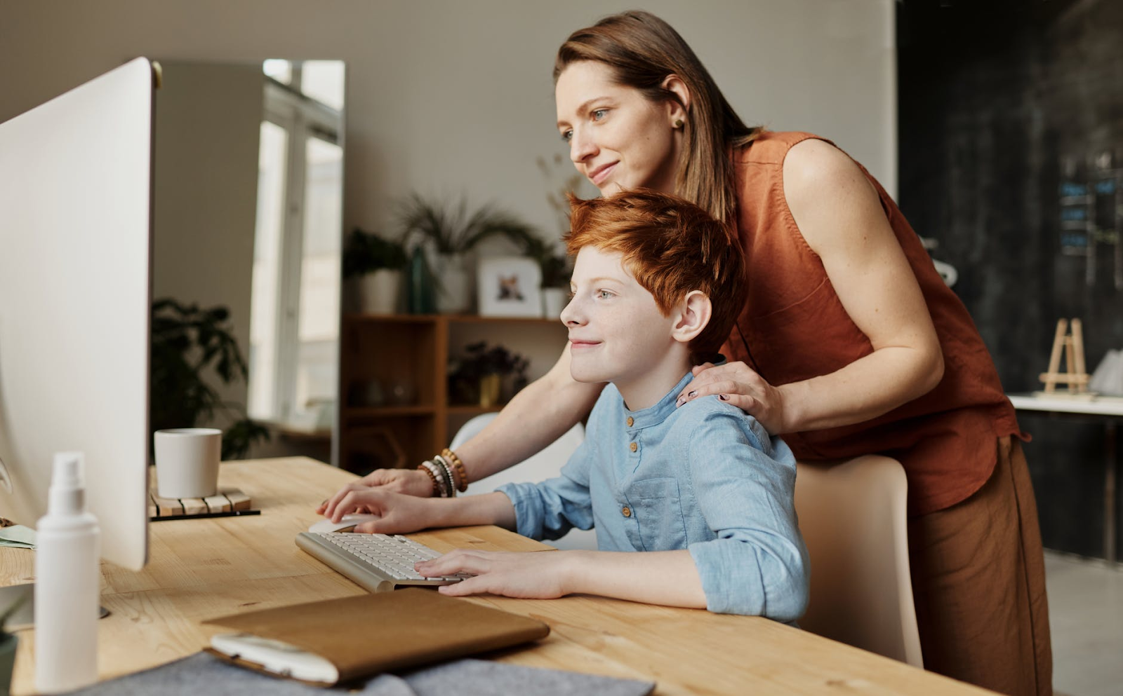 A mother finding an online tutor to schedule an online class for her child at home.