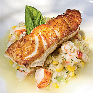 Roasted Grouper with Seafood Risotto and Champagne-Citrus Beurre Blanc.