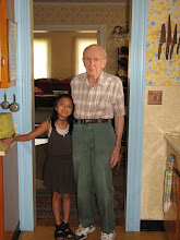 Photo: Gordon and his great granddaughter, Kiandra, in the house on Brainerd.