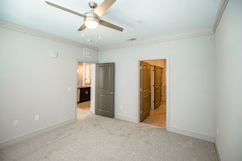 A2 bedroom with light neutral carpet and ceiling fan