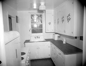 Photo: 1946 photo. This looks like a 30's kitchen with a 40's touch, decals on the cabinets.