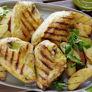 Grilled Chicken with Roasted Garlic-Oregano Vinaigrette and Grilled Fingerling Potatoes.
