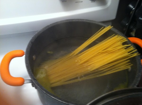 In a separate pan boil water and add spaghetti noodles cook about 7-10 minutes.