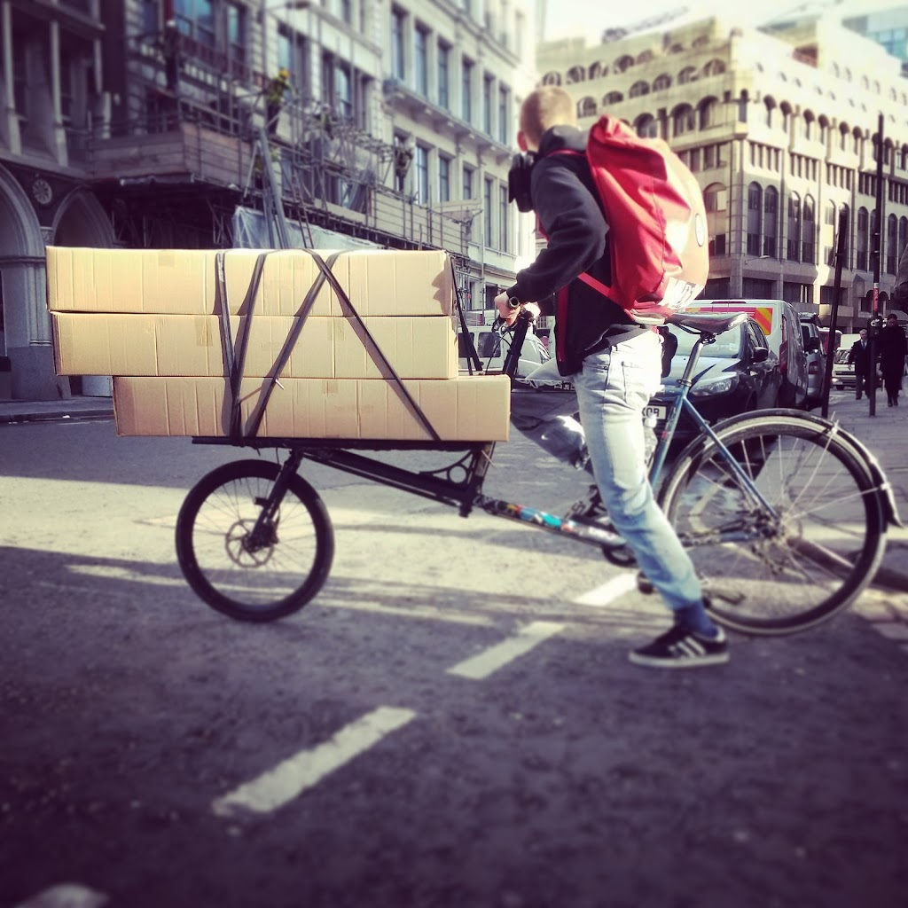 cargo bike courier with large parcel delivery