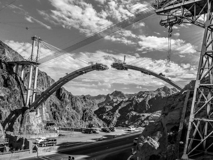 Construction of a bridge by Sergey Sibirtsev - Black & White Buildings & Architecture ( expansive sky, hoover dam, bridge, road, construction,  )