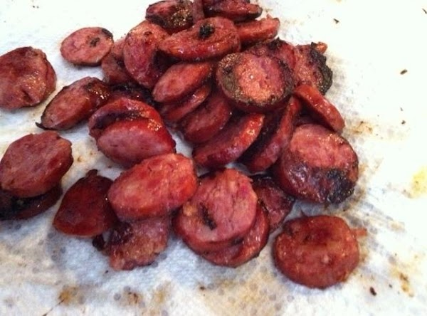 Pat the kielbasa dry with paper towels, then place in a casserole dish.