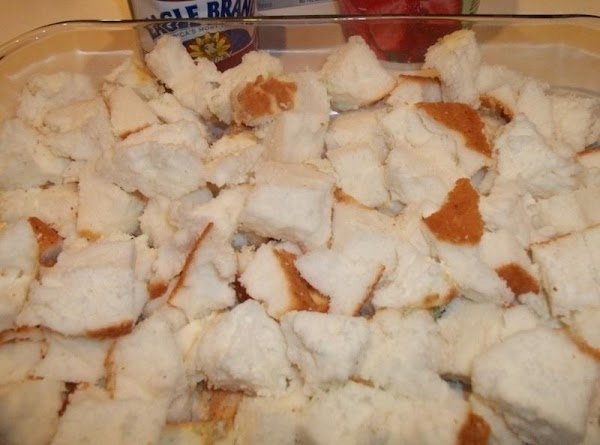 Break angel food cake into bite size pieces into a 9 x 13 dish.  ...