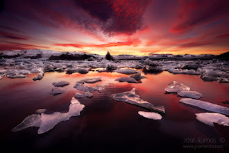 """Photo: """"Dissolution of Eternity""""  The Jokulsarlon Glacier Lagoon under fiery light, in it's endless cadence of moving pieces of ice, teaches us lessons of impermanence and dissolution.  This place is quite simply the most beautiful work of moving art I've ever seen in my short life.  Story:  After two trips to Iceland and much waiting, finally had the chance to witness an epic sunset at Jokulsarlon, with enough time to choose from the endless possible angles and compositions. Due to the fast moving pieces of ice, doing a long exposure would be impossible. Since the ice pieces were a few meters aways from the shore and I wanted to get the classic immersive look of ultra wide angle lenses, had to enter into the almost frozen water to get this image. From time to time, chunks of melted ice would meet my legs with great subtleness, making me fell like a part of the whole moving scenario. Unforgettable.  Technical details:  Sony a7R + Zeiss 16-35mm f4 Aperture: f/10 Exposure: 1/8 seconds ISO: 200 Manual Focus Formatt Hitech 3 stop Firecrest soft ND Grad Manfrotto 055XPRO3 tripod Terrascape filter bag  José Ramos ©  #iceland  #icelandphotography  #jokulsarlon  #glacier  #glacierlagoon  #sunset  #sunsetphotography  #landscapephotography  #landscapephoto  #stunningmoment  #photomaniaportugal  #photomaniaglobal  #sony  #sonyalpha  #sonyphotography  #sonya7r  #a7r"""
