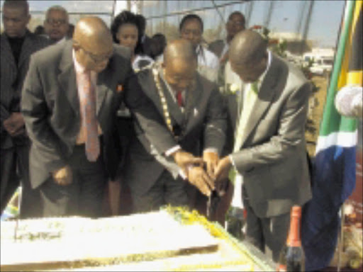 HAPPY BIRTHDAY: Former executive mayor of the Mopani district in Limpopo Humphrey Mokgobi, left, current executive mayor Joshua Matlou, and local government and housing MEC Soviet Lekganyane cut a cake to celebrate Nelson Mandela's 91st birthday in Bolobedu on Saturday. Pic: MICHAEL SAKUNEKA. 19/07/2009. © Sowetan.