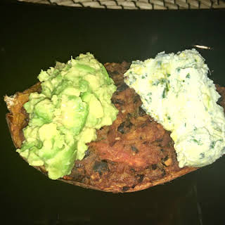 Harissa and Black Bean Loaded Sweet Potato Skins with Whipped Feta and Smashed Avocado.