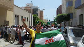 Trabajadora del SAT durante la manifestación en El Ejido.
