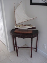 Photo: Antique table and Beetle Cat Model Ship