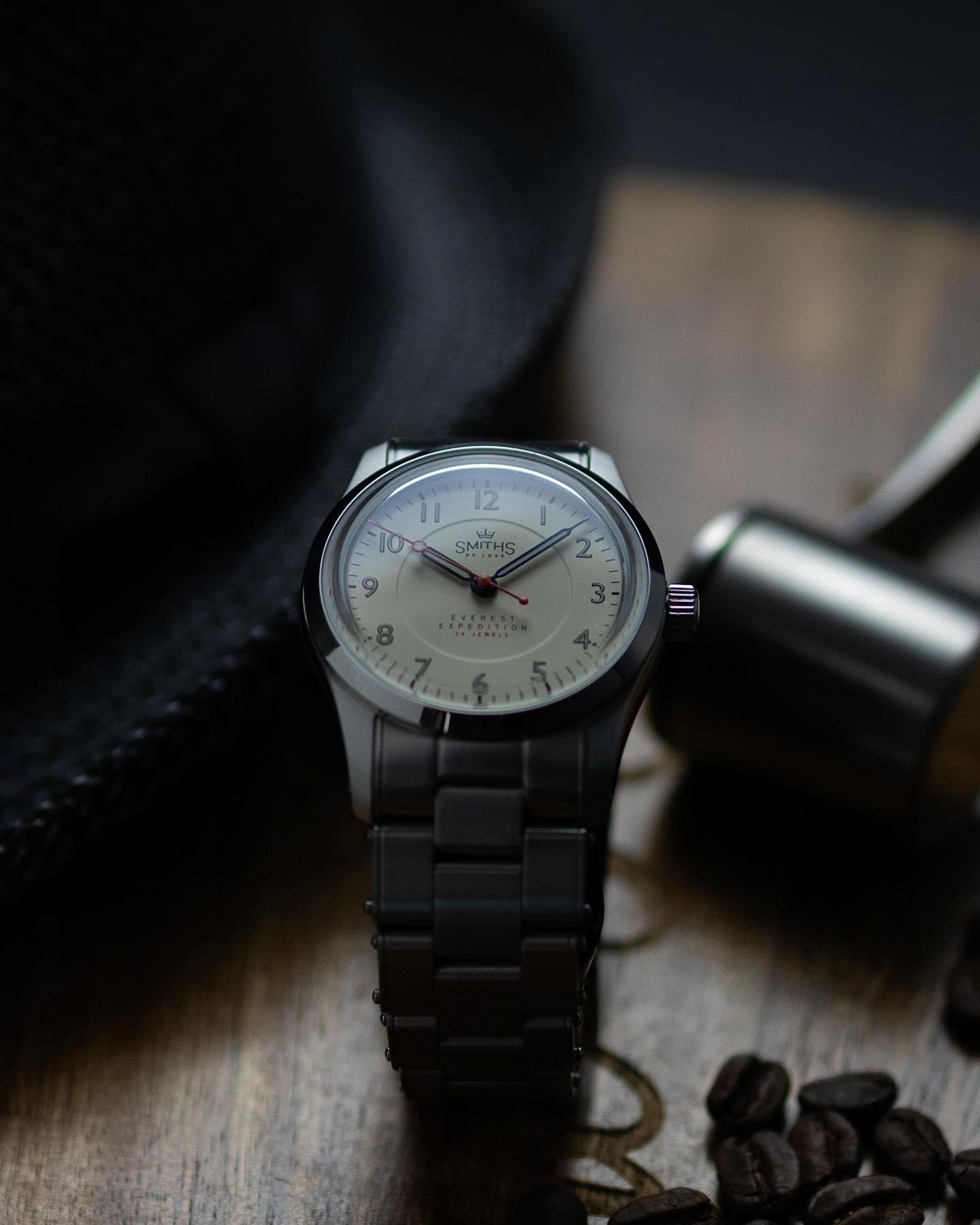 A silver watch on a wrist  Description automatically generated with low confidence