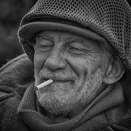 Happy Moment by Marco Bertamé - Black & White Portraits & People ( cigarette, ww2, break, soldier, headshot, smoking, helmet, military, no eyes, portrait, eyes closed )
