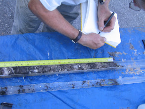 Photo: Making field notes, and taking samples. The liners can be retaped and repacked for further analysis.