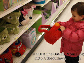 Photo: Uh-oh, she's finding more stuff to tote around with her.