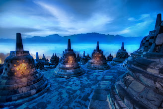 """Photo: The Beating Hearts of the Buddhas - Borobudur, Indonesia  I tried something a little bit different with this photo. I was holding two flashlights to help me climb the temple in the morning. I think I got there about 5:30 AM when it was still pitch black, so the flashlights helped me find the right footholds and whatnot. Anyway, this was an extremely long exposure, so I used some of that time to """"paint"""" the inside of the bell cages with the beams of my flashlights. Each of those bell cages held a solitary outward-facing Buddha. I'm glad I was there alone, because I'm sure I looked like a loon running around shining the flashlights in patterns to illuminate the Buddhas inside.  from the blog at www.stuckincustoms.com"""