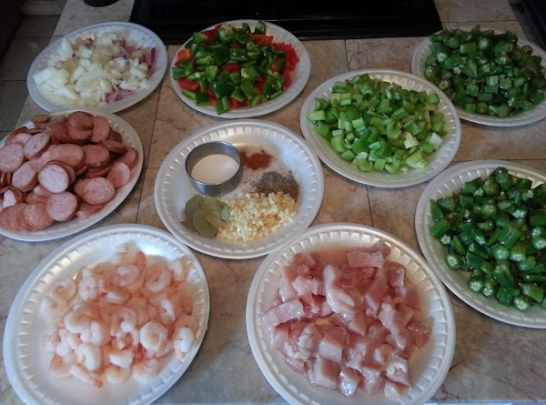 For a normal 6 serving meal, cut this gumbo recipe in half.  These are the ingredients I used to make enough for 18.  Missing is another plate of sausage and more chicken.