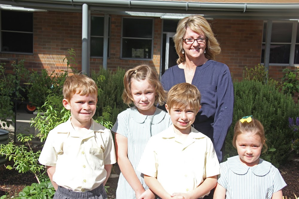 FAREWELL: St Francis Xavier's School principal Katie Hanes is leaving at the end of this year, pictured here with students James Paas, Ruby Irwin, Ben Vankuyk and Winnie Winston-Smith.