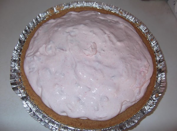 Whisk in cool whip.  Fold in watermelon.  Spoon into crust.  Cover...