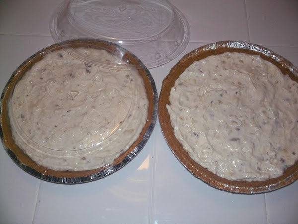 Combine all ingredients and mix well. Evenly divide between the two graham cracker pie...