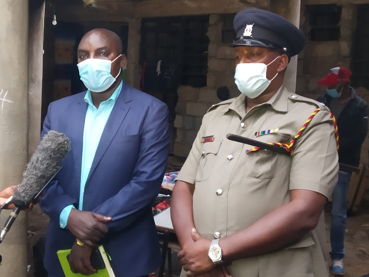 Ruiru criminal investigations officer Cyrus Ombati and subcounty police commander Phineas Ringera speak to journalists at the scene on Monday, May 3, 2021