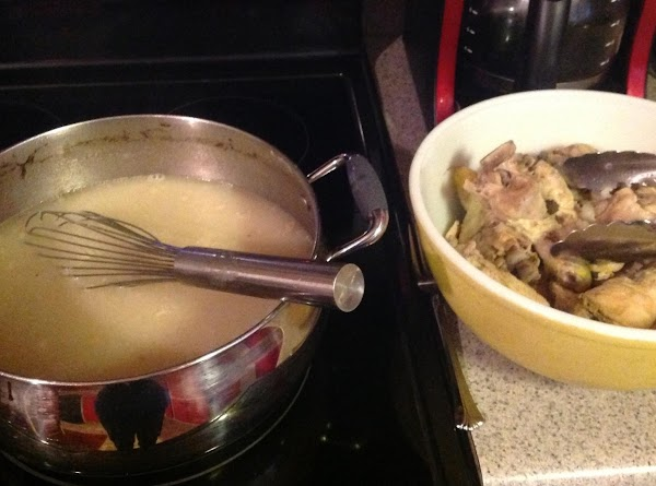 When chicken is done, take out of chicken stock and set aside to cool.