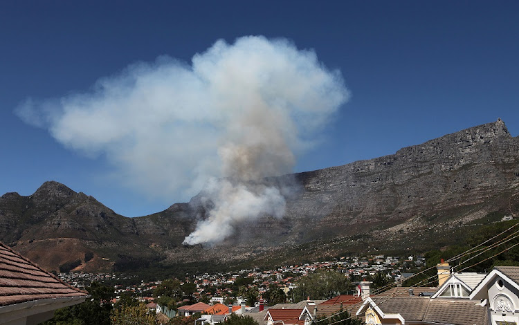 Smoke rises from a fire on table mountain on Saturday, 17 March 2018.