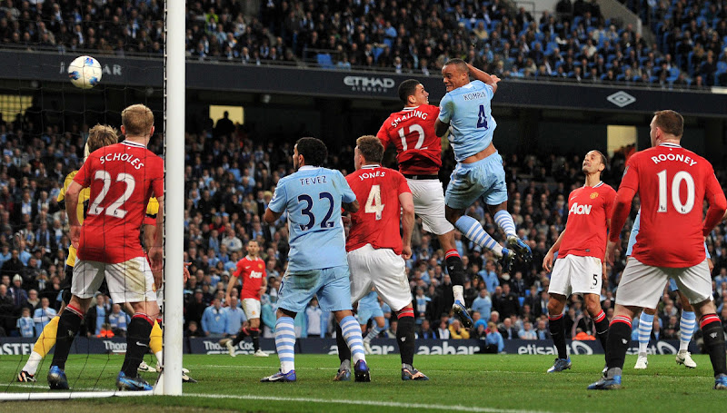 Photo: Manchester City's Vincent Kompany scores his teams first goal during the Barclays Premier League match at the Etihad Stadium, Manchester.