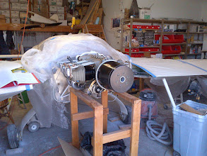 Photo: the engine mounted on the firewall with James Redmon's lamp-shade spinner flow guide in place.