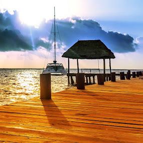 Sunrise by Jeffrey Genova - Buildings & Architecture Bridges & Suspended Structures ( water, beaches, waves, mexico, ocean, beach, sunrise, sailboat, dock,  )