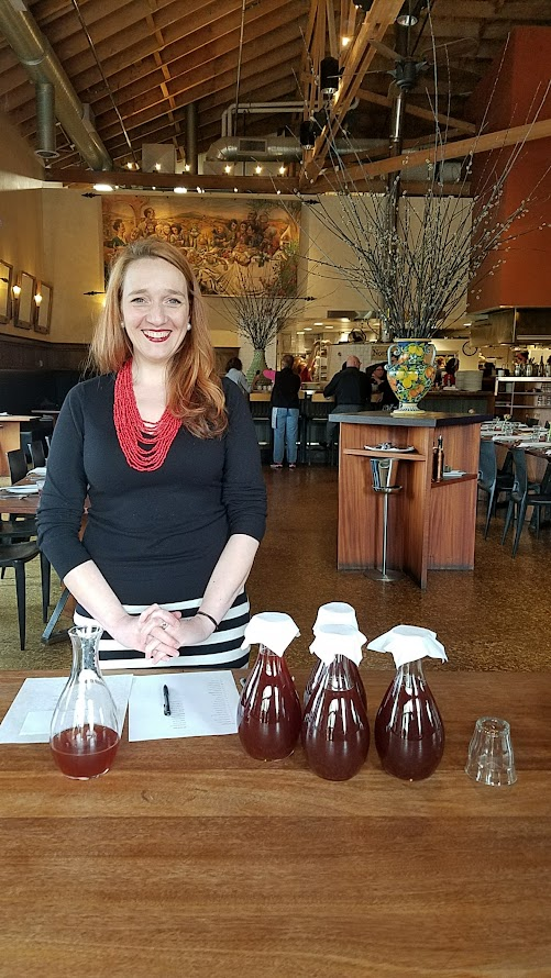 Breaking Bread coordinator Libby Clow welcomed guests with some kombucha from Farm Spirit after checking their names
