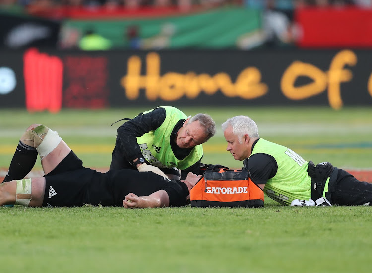 The All Blacks loose forward Sam Cane receives medical attention during the Rugby Championship match between South Africa and New Zealand at Loftus Stadium in Pretoria on October 6, 2018.