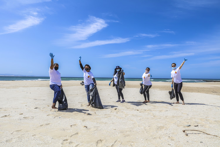 Employees participate in the annual International Coastal Cleanup Day.
