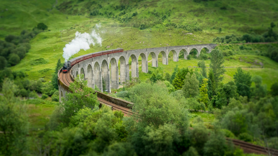 Harry Potter train going through rolling hills