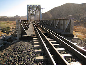 Photo: Railroad bridge over the Mojave River. This spot provides an excellent point to watch the passing freight trains. Even though the bridge provides the easiest route over the Mojave river at this time of the year, its use by non-authorized personnel is considered trespassing.
