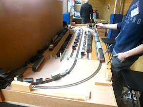 """Photo: 128 A simple line running through the scenery on the visible side of the layout does not necessarly mean that it has to be equally simple on the operating side – as seen by this comprehensive and spacious traverser fed plus continuous """"test track"""" line behind Plas Halt ."""